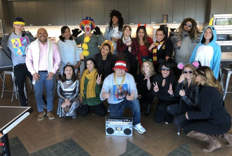staff group photo in halloween costumes